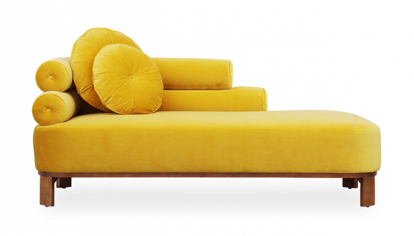 yellow daybed with round pillows on white background