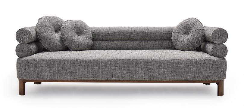 medium grey sofa with round pillows on white background