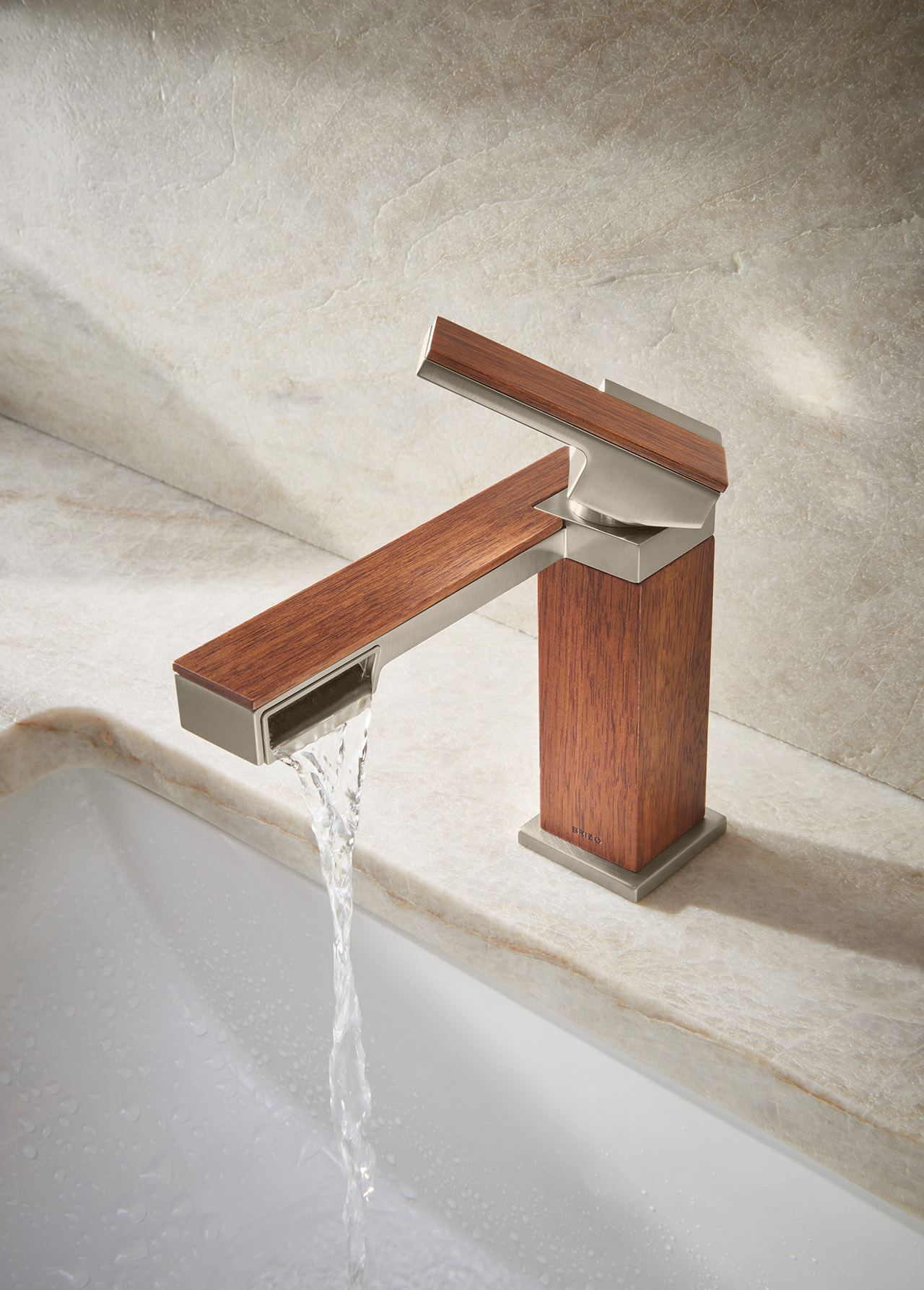wood and metal angular sink faucet with water turned on