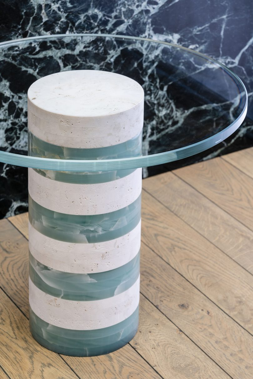 blue and white striped table with round glass top