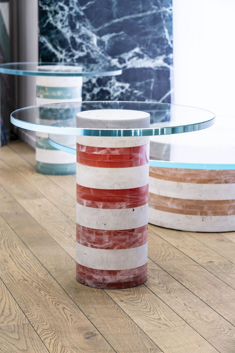 two striped tables with round glass tops