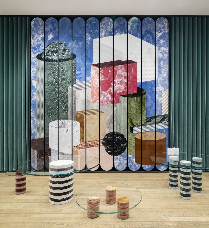 striped objects in front of a large wall mural