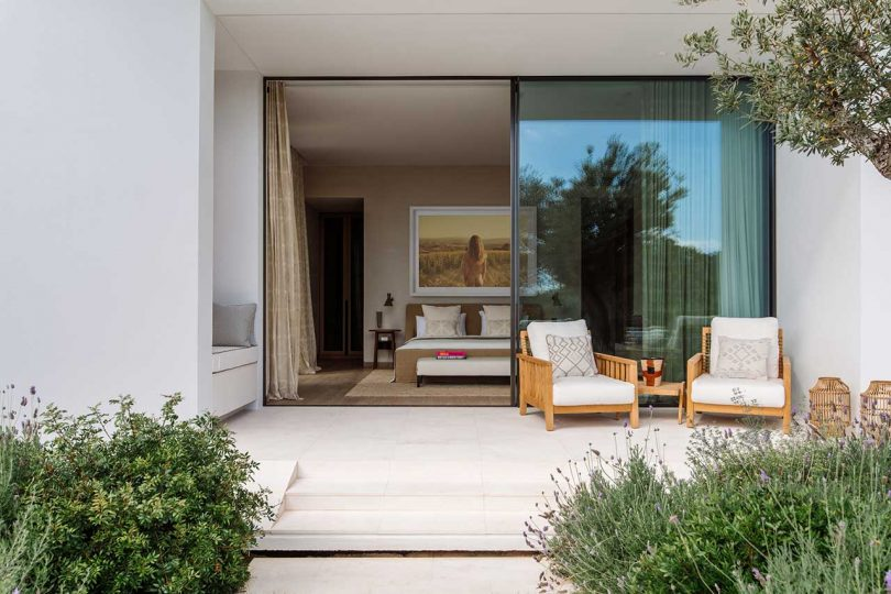 view from outside into a modern bedroom