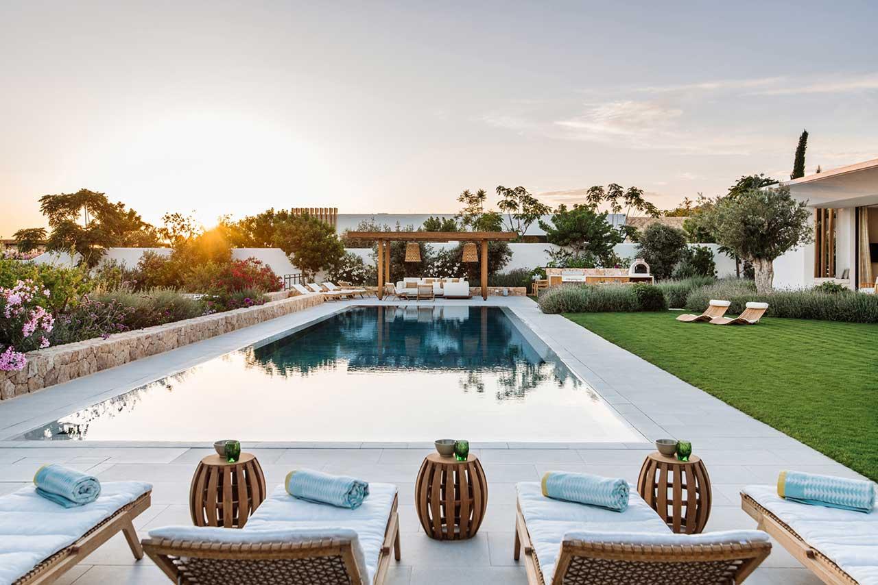 swimming pool with modern wood furniture