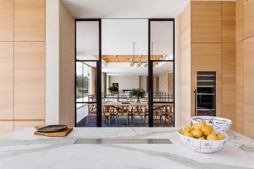 view from modern kitchen into open living space