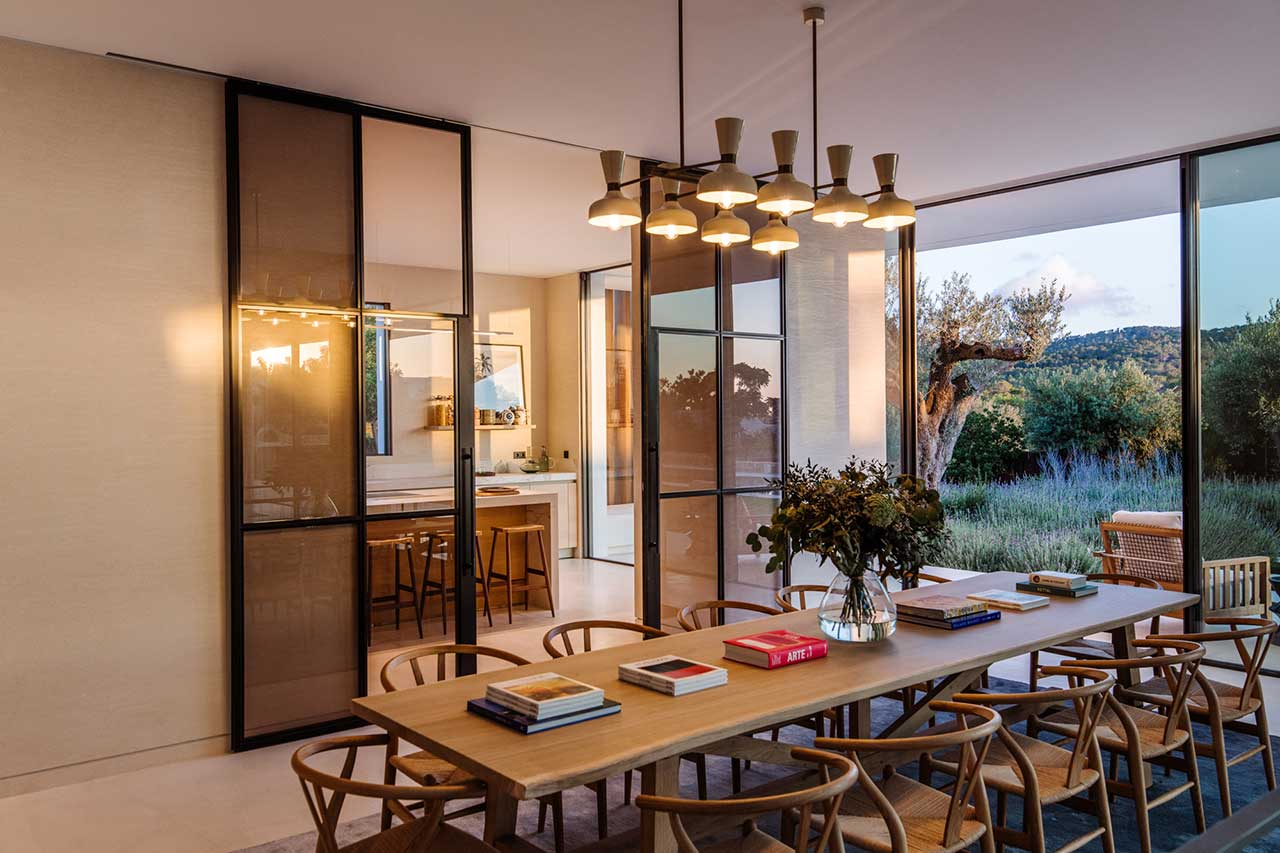 evening view of dining room looking into kitchen and outside