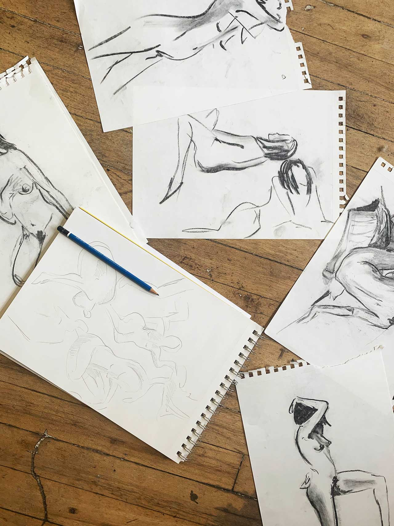 black and white figure sketches askew on table