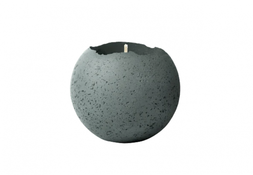 round concrete vessel holding a candle