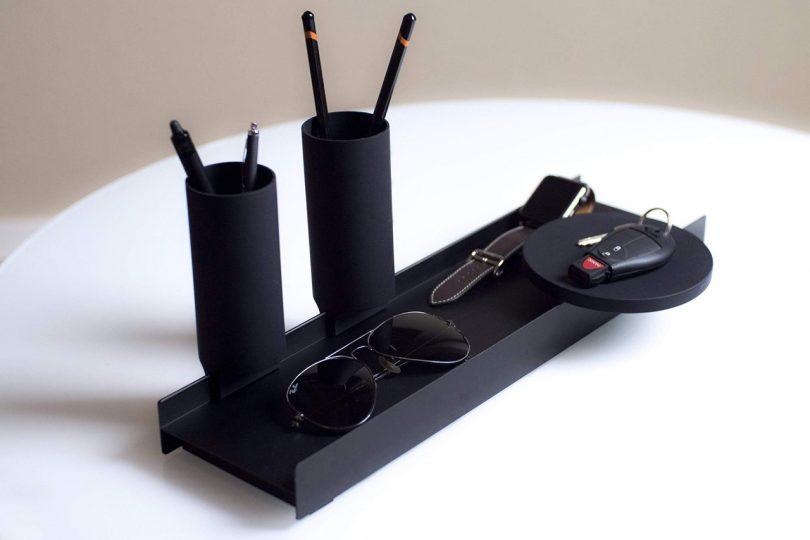 black desk organizer on white surface