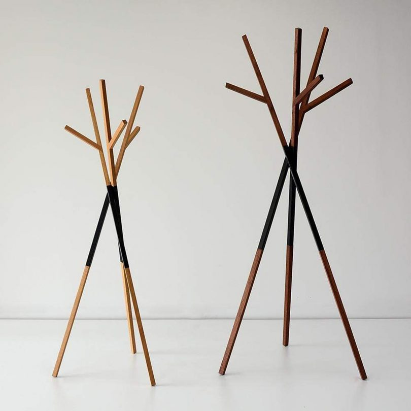 two clothes stands resembling trees on light background