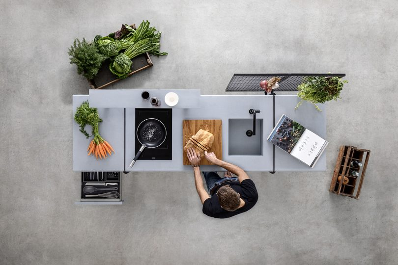 overhead shot of open space styled kitchen on concrete floor