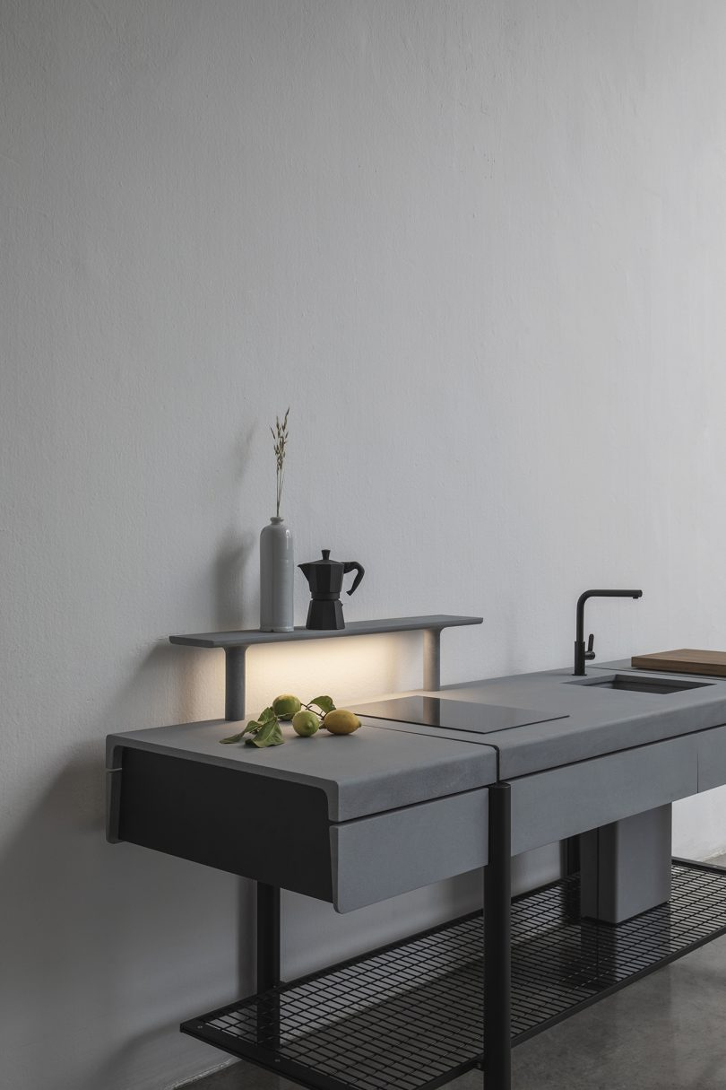 open space kitchen in situ with light on against light wall