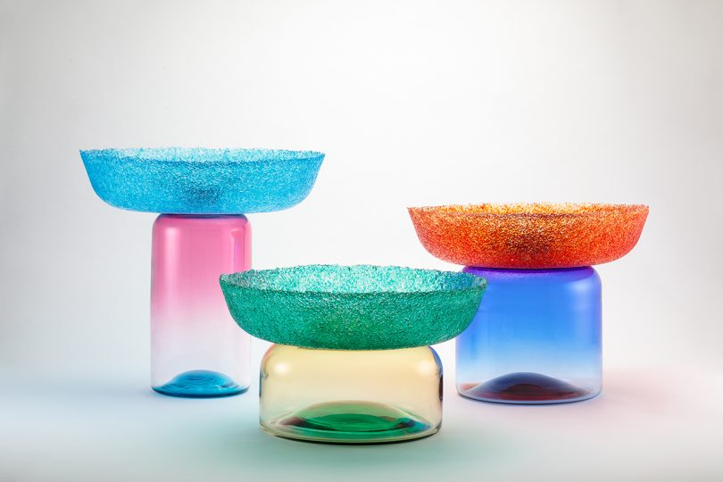 three multicolored glass bowls/vessels on white background