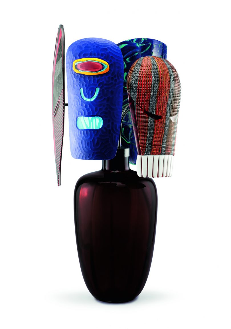 sculpture with dark base and colorful upper half