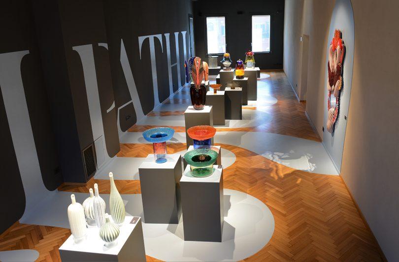 overhead photo of an art exhibit with pedestals