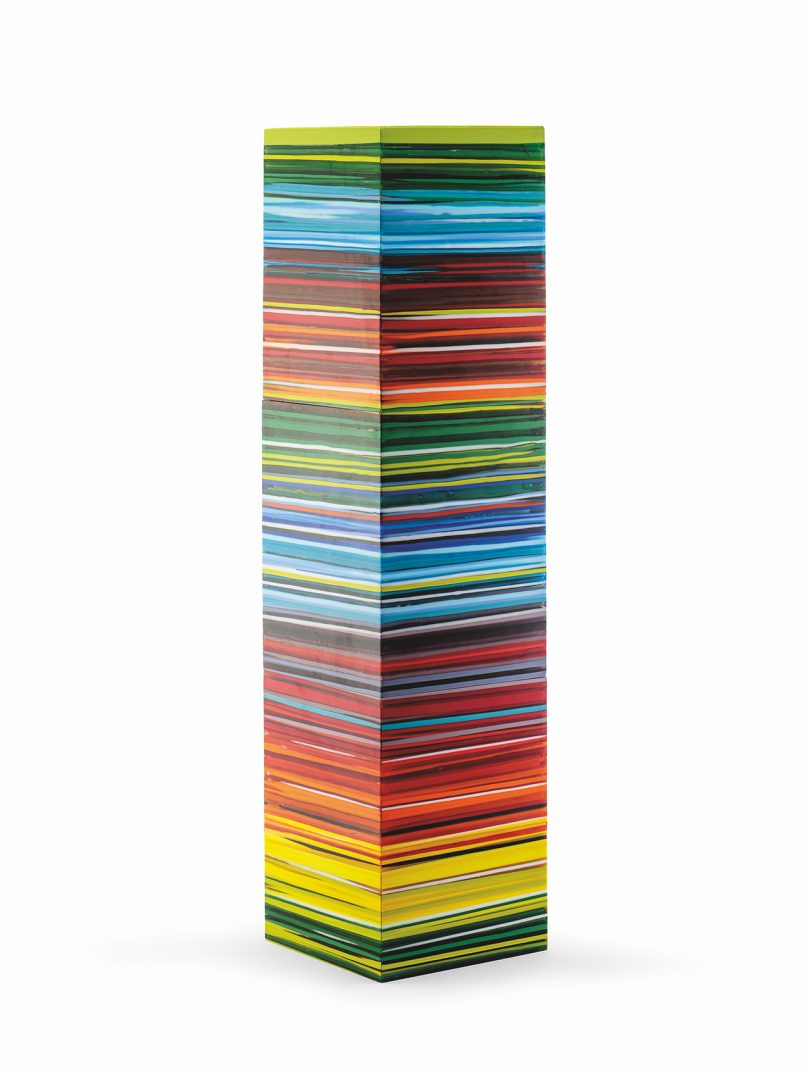 tower-like sculpture with striated banks of color