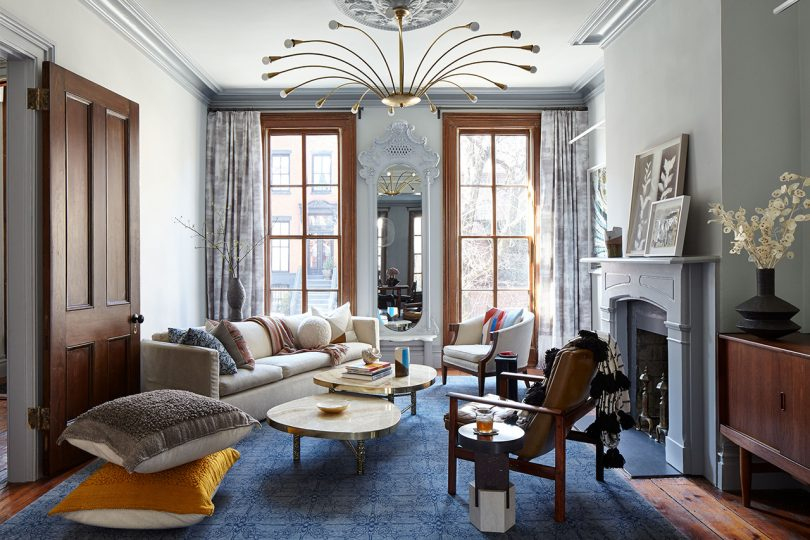 opulent interior space with architectural light fixture and furniture