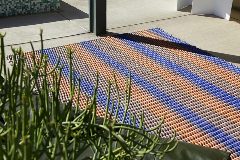 multicolored striped rug on pavement