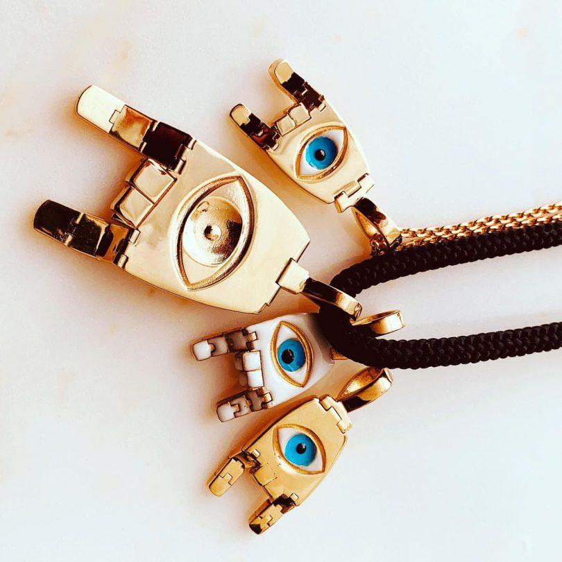 golden eye pendants on necklace