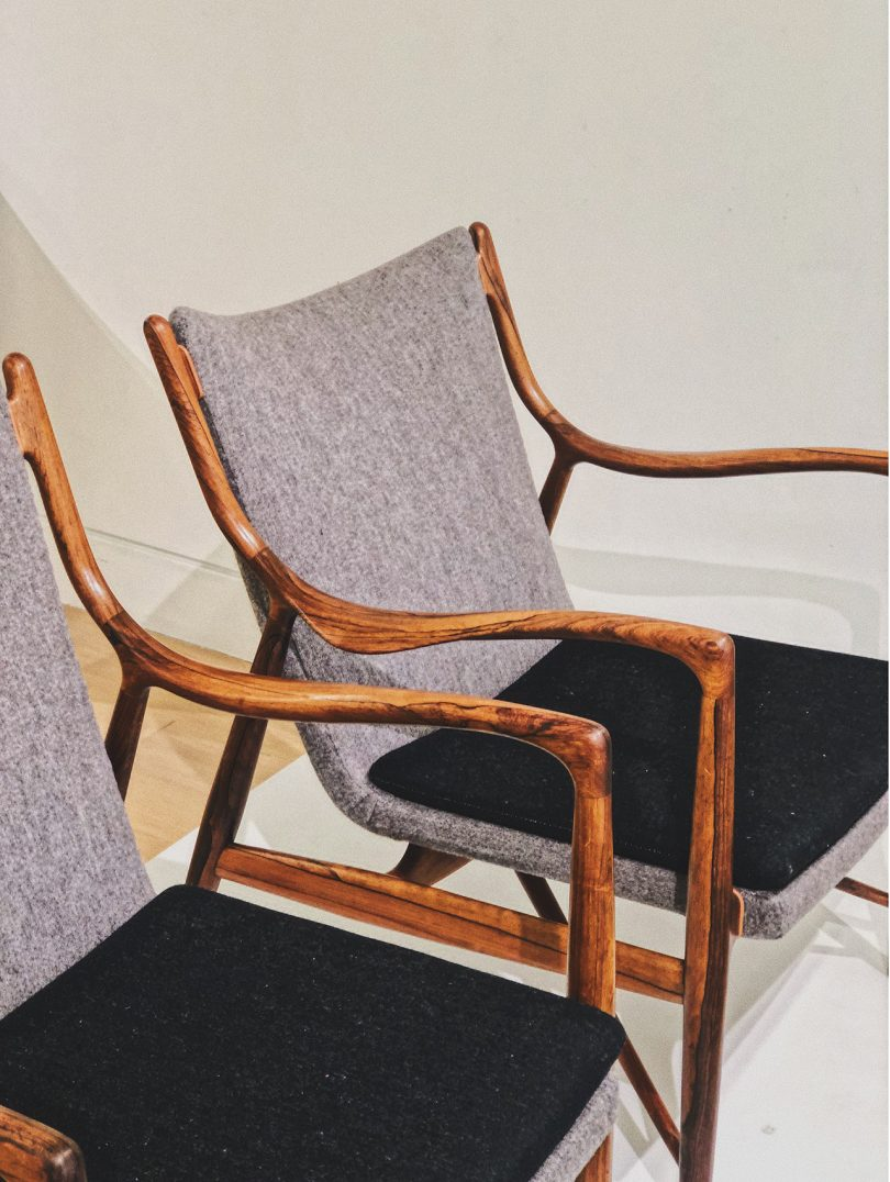 two mid-century chairs side by side
