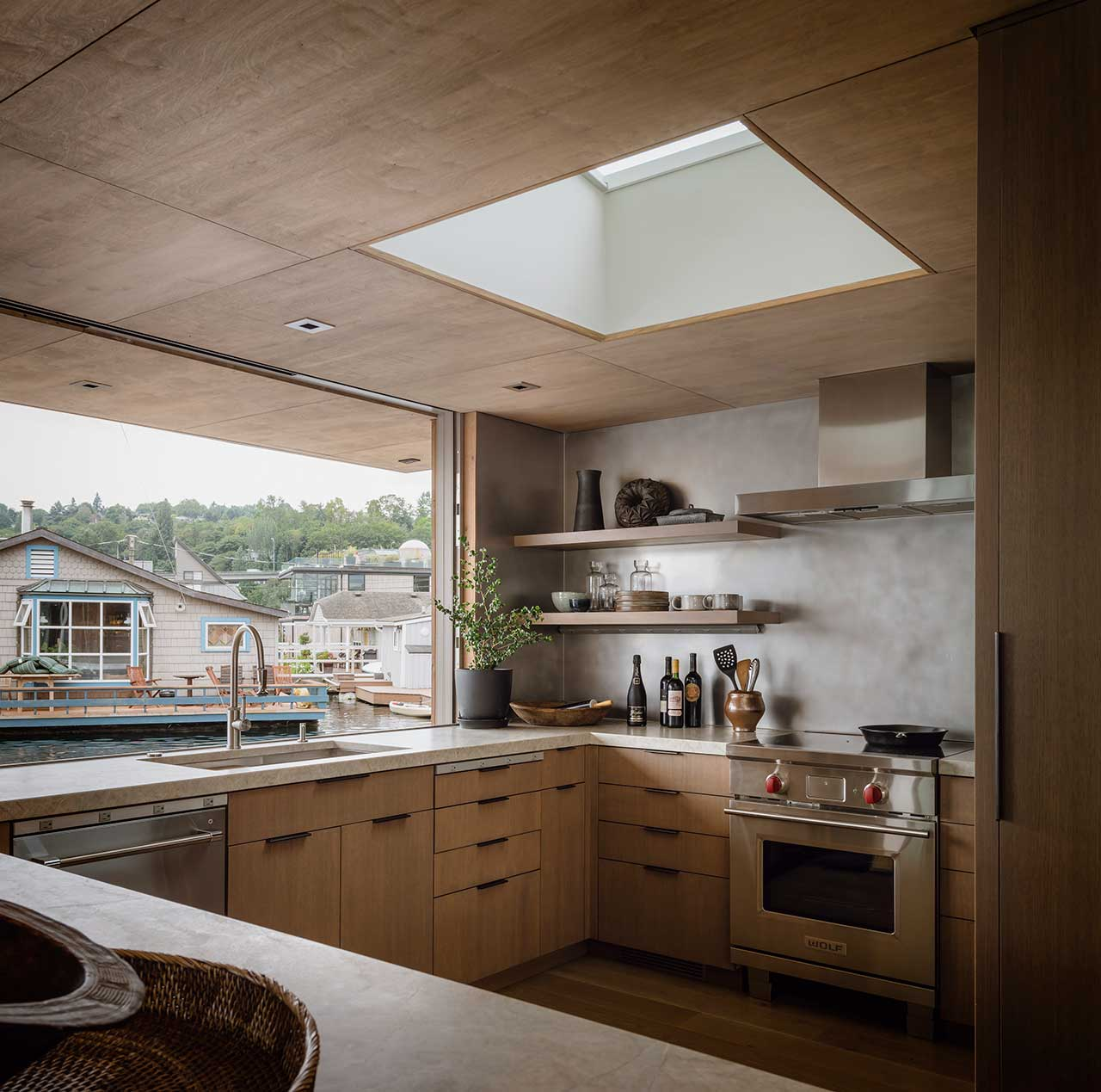 modern kitchen in floating house looking out to water