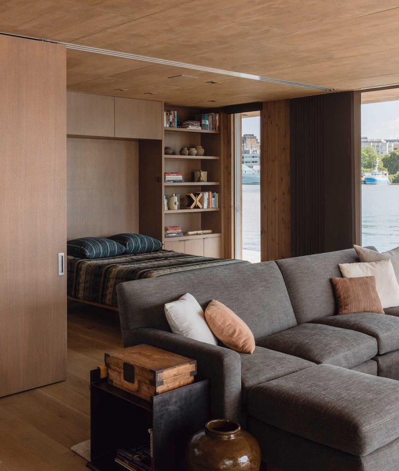 modern interior of floating cabin on water with murphy bed