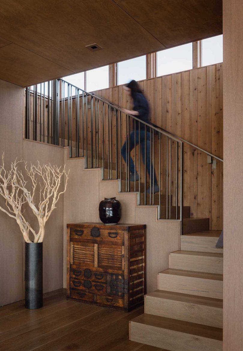 modern staircase with person walking up to second floor