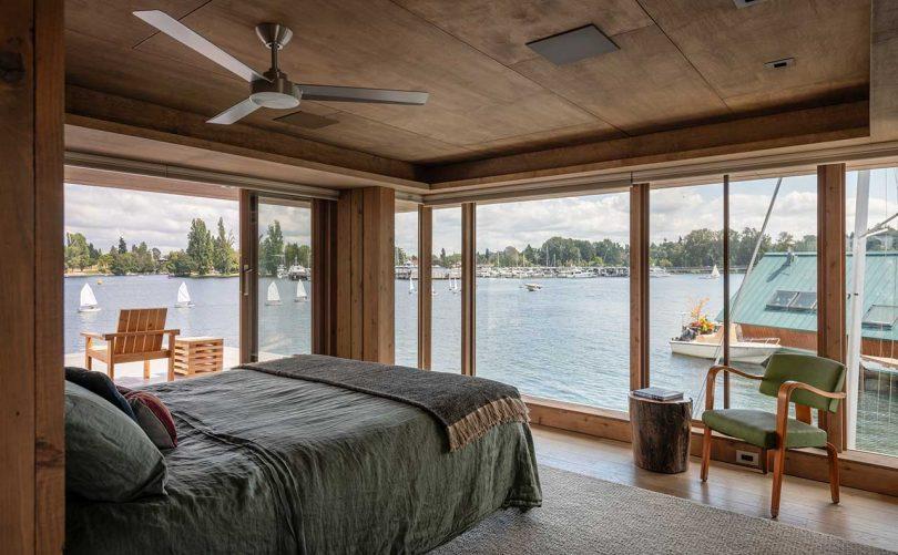 modern bedroom in floating house overlooking surrounding water