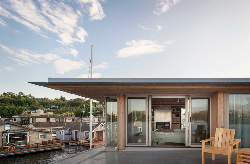 exterior view into modern bedroom of floating house