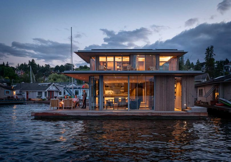 modern floating house on water in the evening