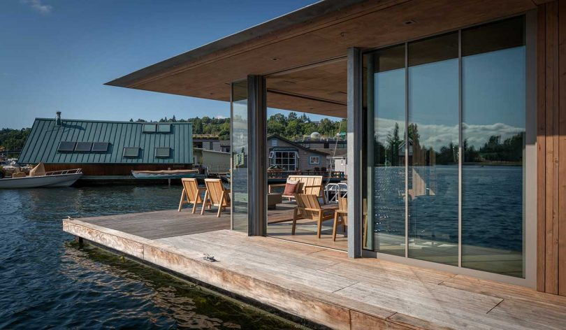 modern cabin floating in the water with sliding glass doors open