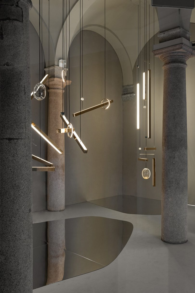 light fixture exhibit inside marble and stone space