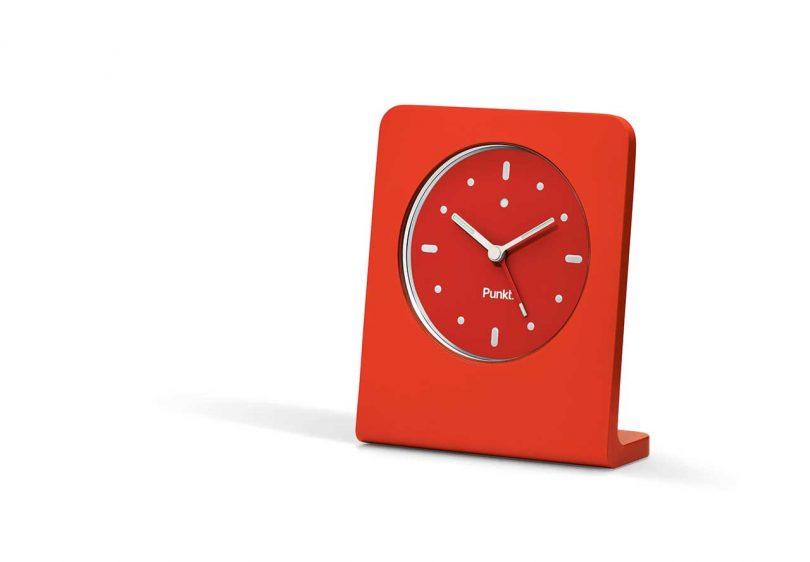 red standup modern clock with white numbers and hands