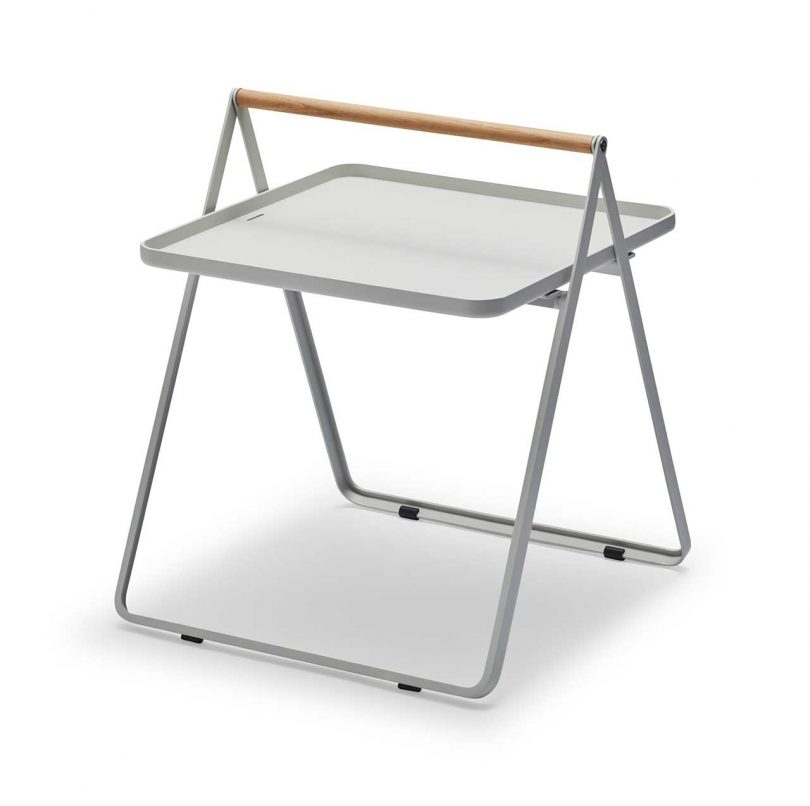 pale gray fold up metal table with wood handle