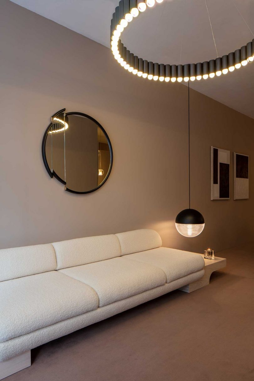 showroom vignette of modern lighting and accessories by Lee Broom