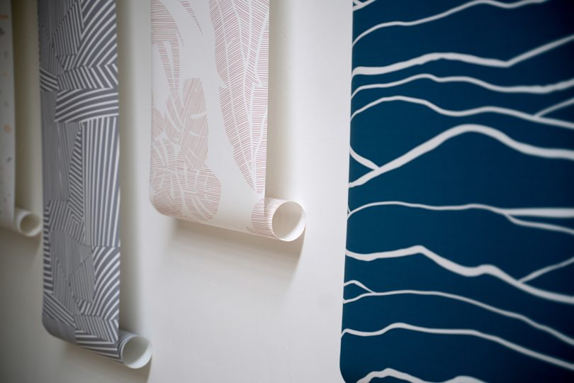 reams of patterned wallpaper hanging