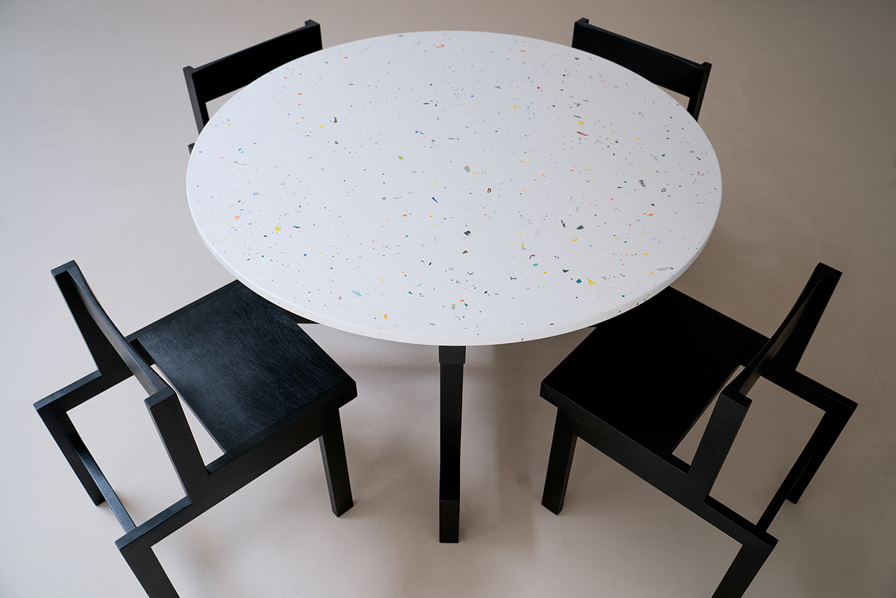 round white table surrounded by four dark dining chairs