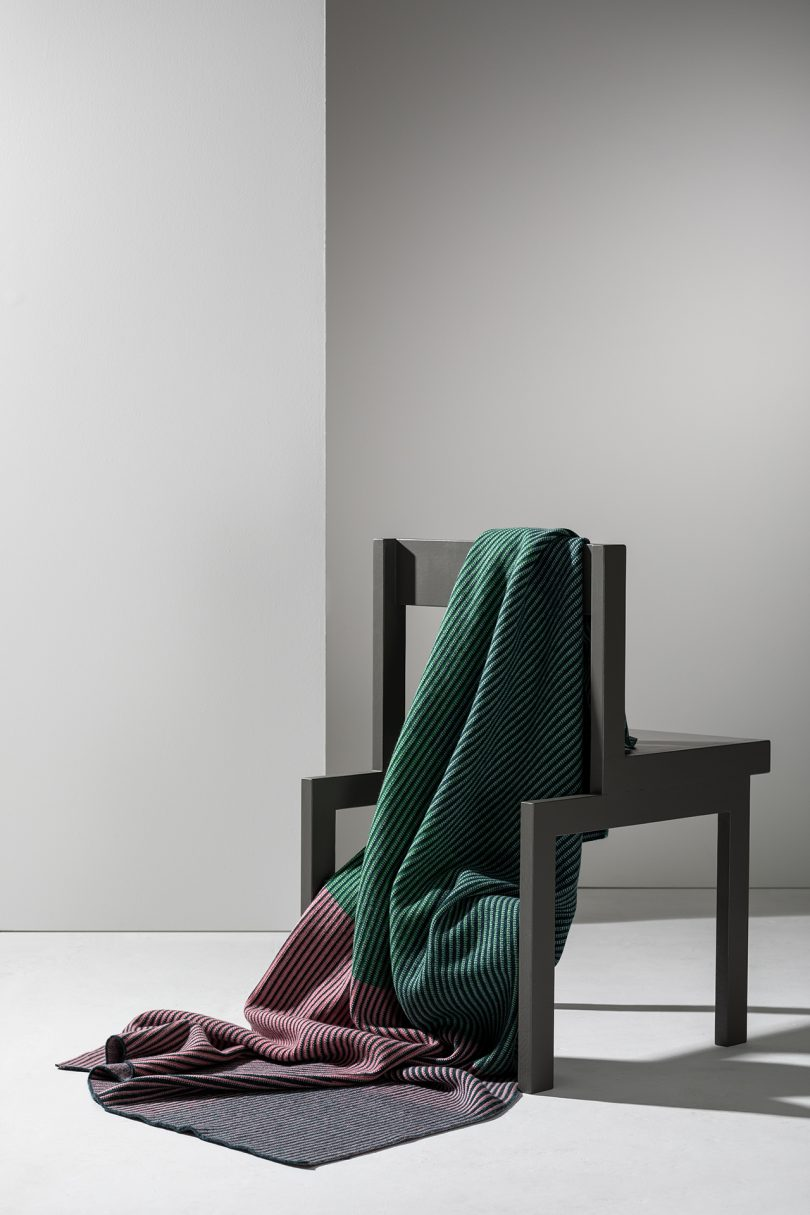 chair with handmade blanket in white room