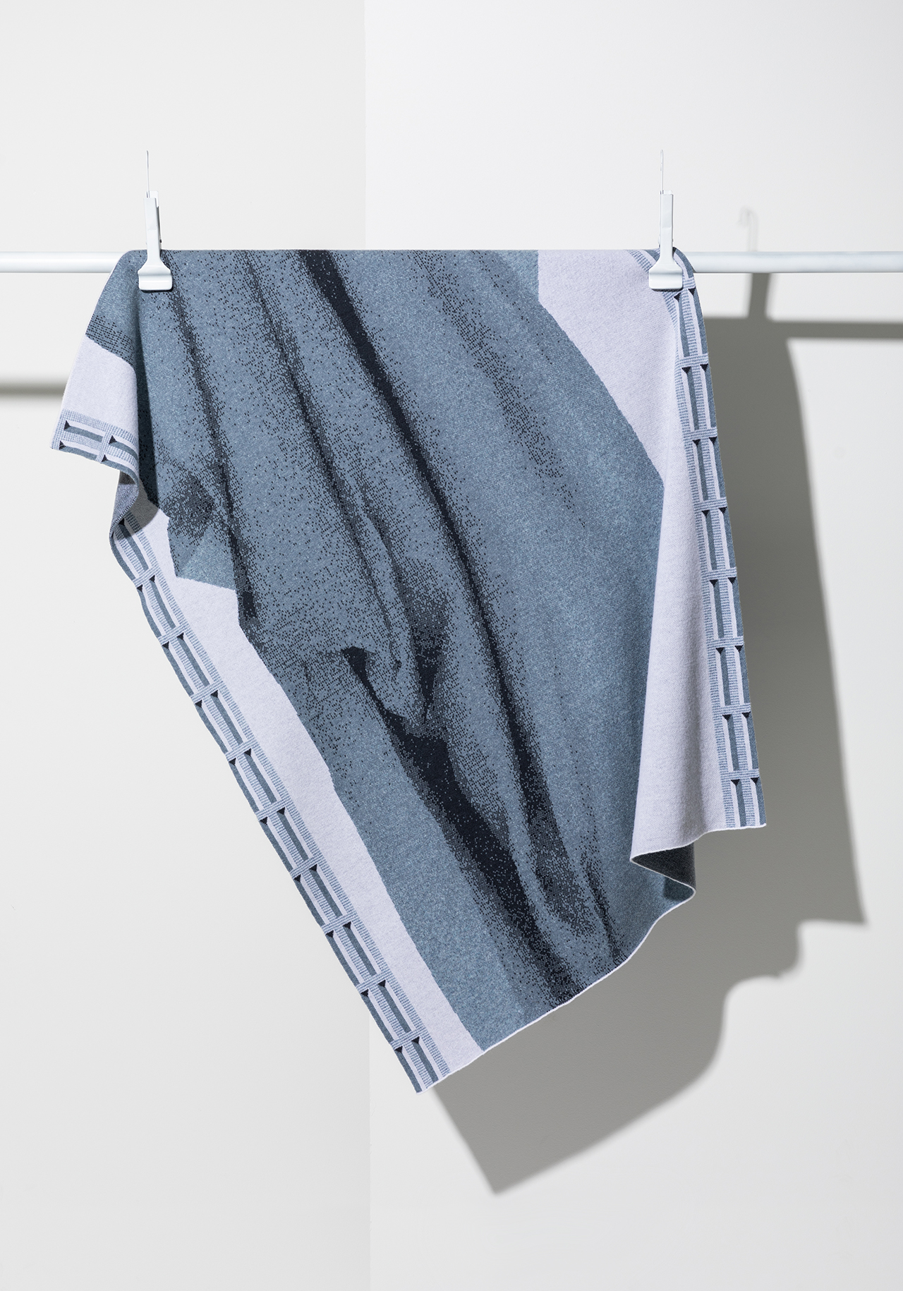 blue and grey textile hanging on wall