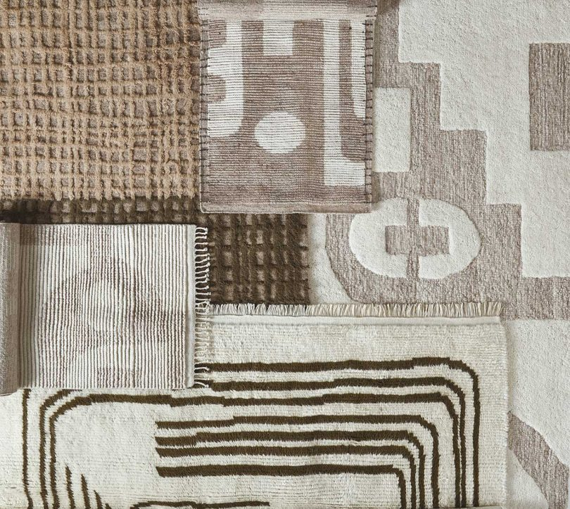 layered flat of several neutral rugs