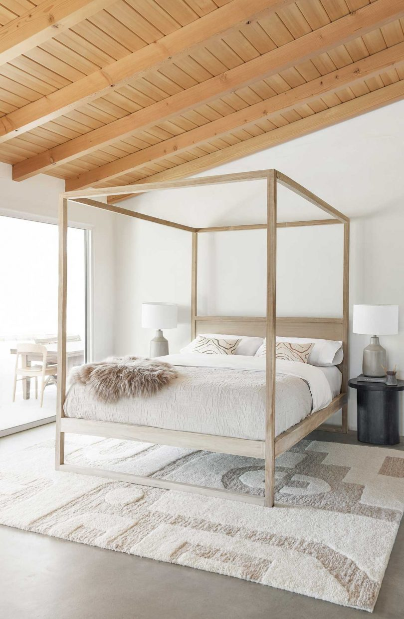 Modern bedroom with canopy bed and neutral textiles
