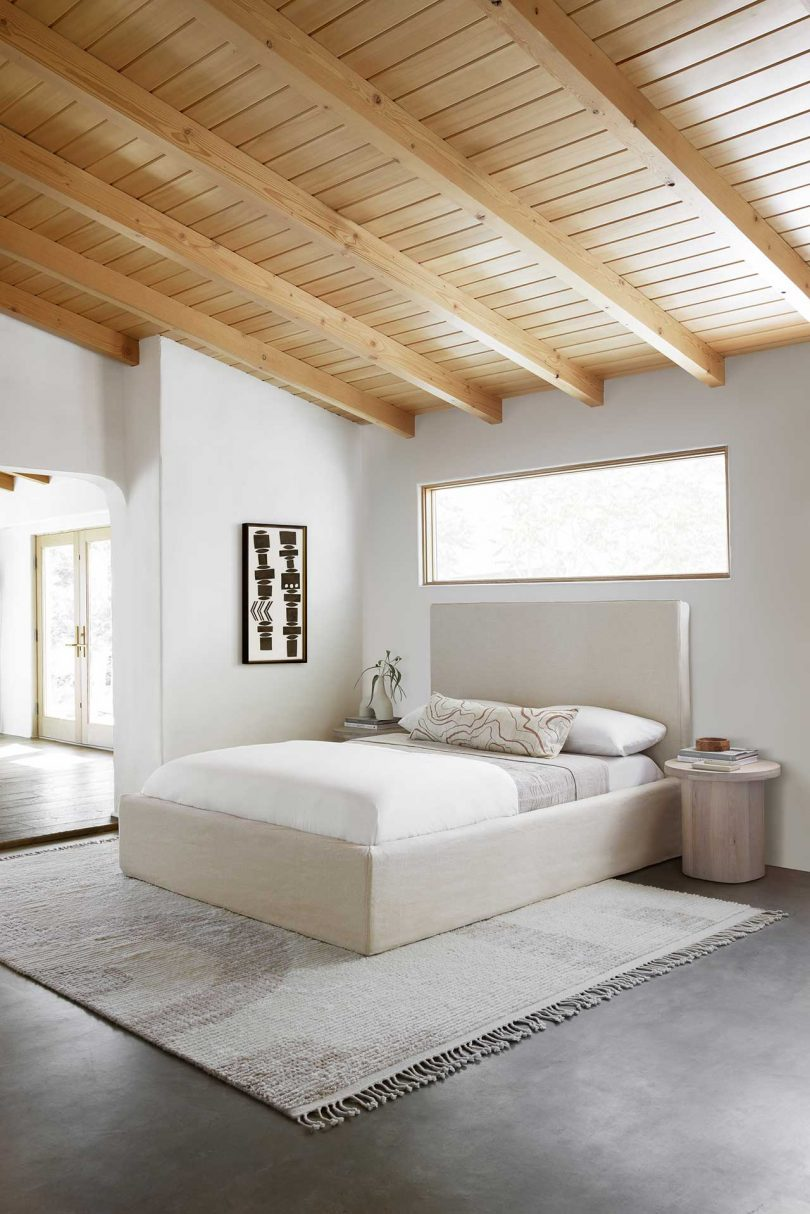 modern bedroom with neutral textiles