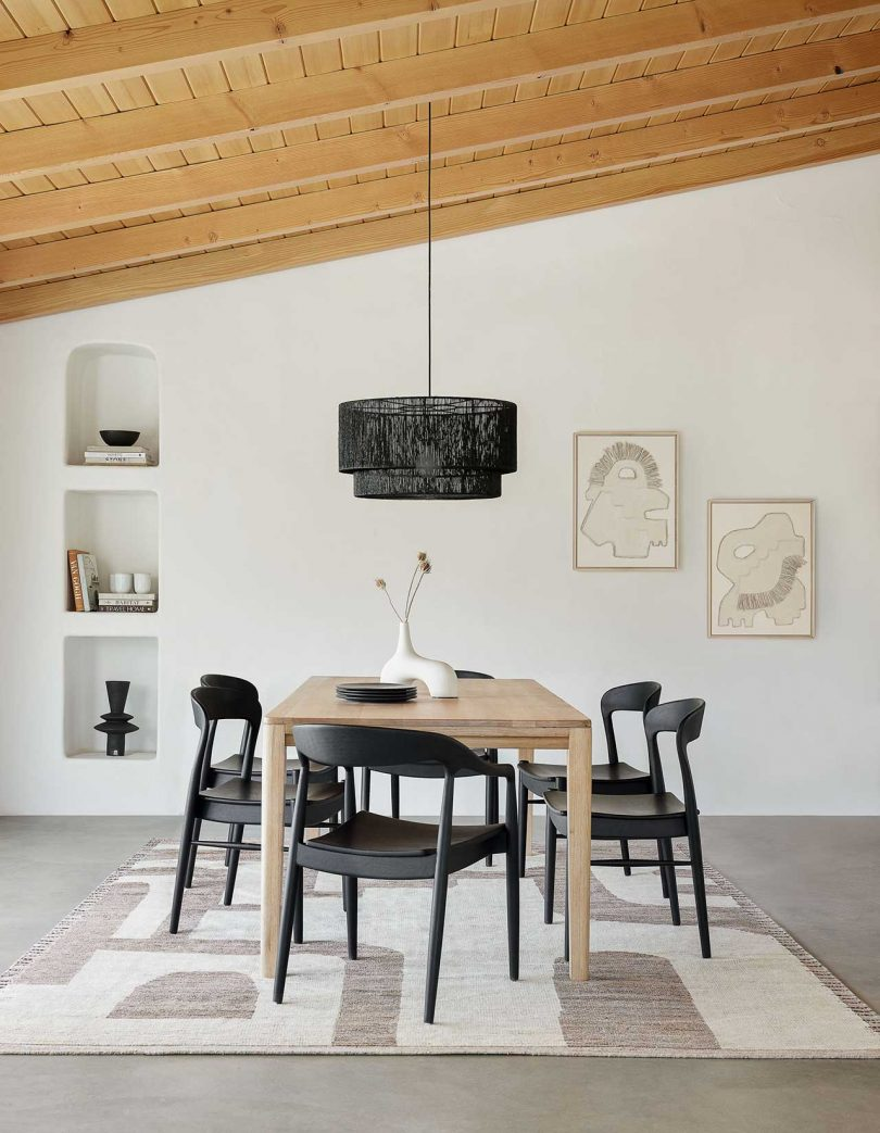 Modern dining room with wood table and black chairs