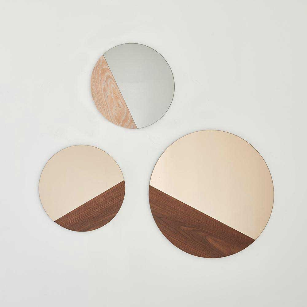 three round mirrors with sections of wood