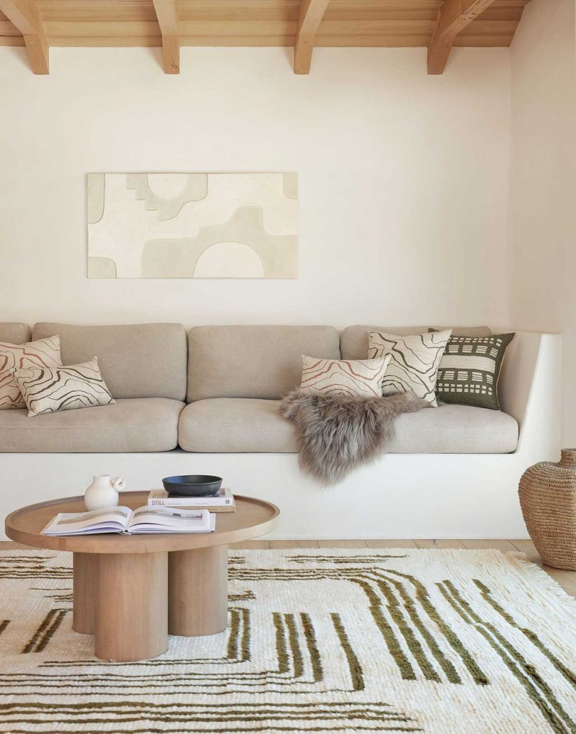 modern living room with sofa, rug and table in neutral colors