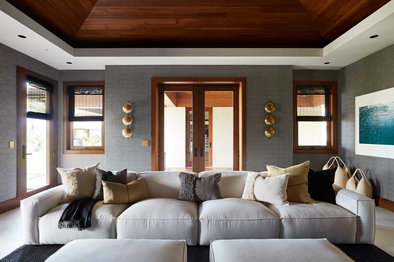 modern seating area with white sofa and throw pillows