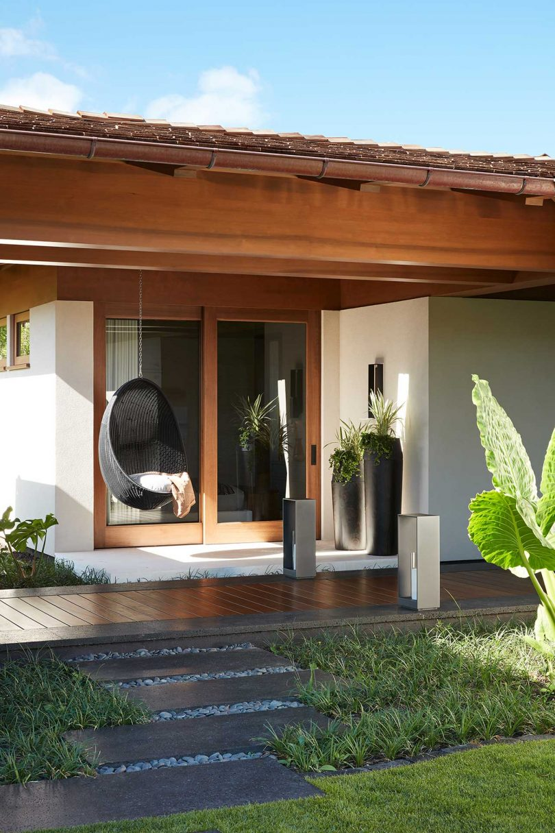 outdoor view to exterior terrace with hanging black chair