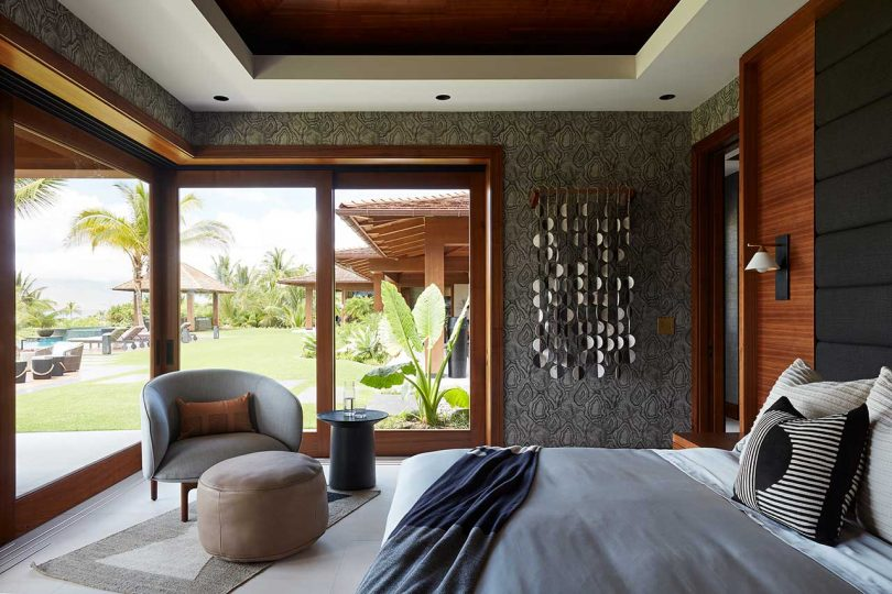 modern bedroom interior with corner windows to the tropical outdoor space