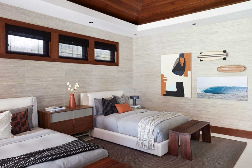 modern guest room with two beds in neutral tones