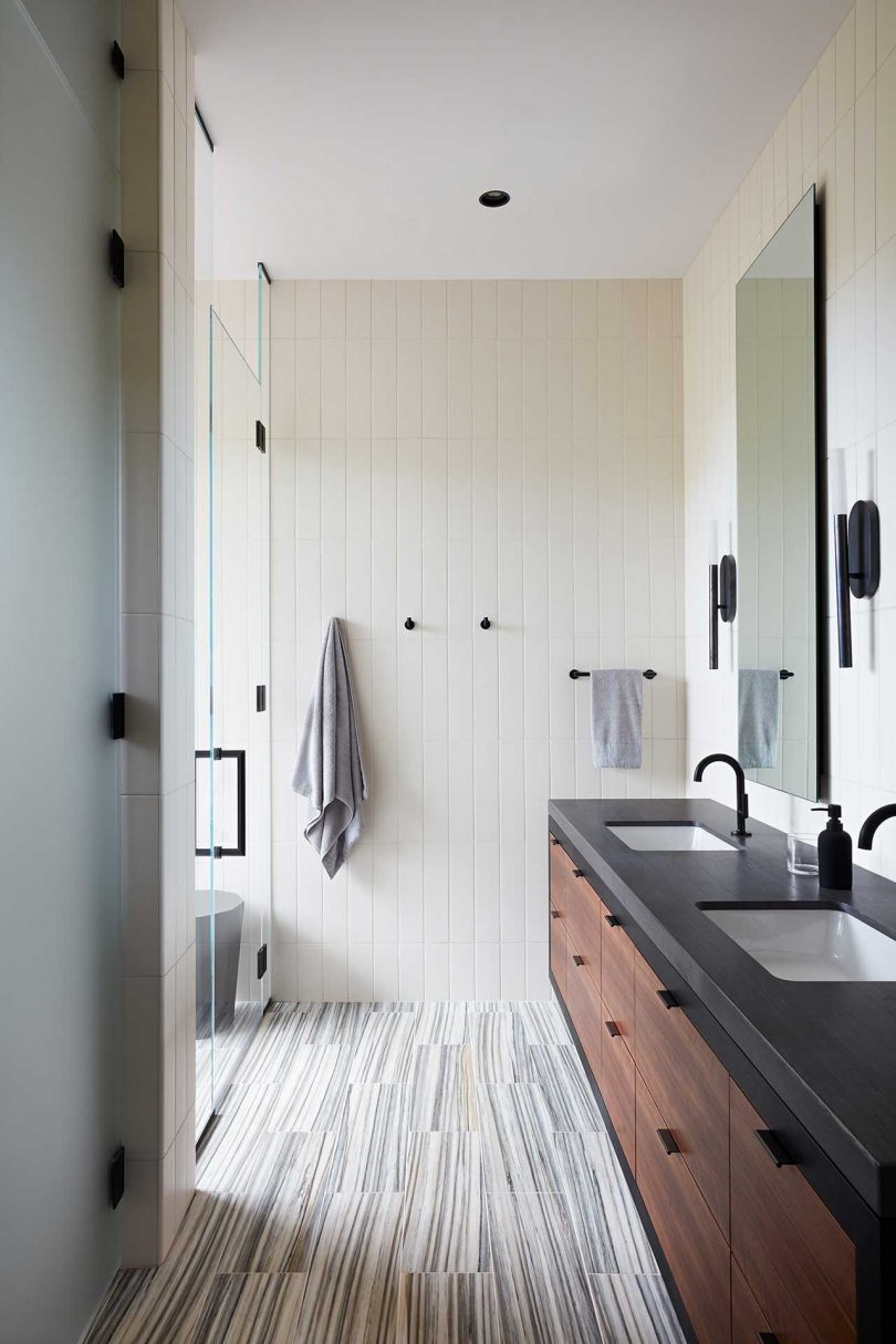 modern bathroom with floating wood vanity and open shower